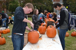 Pumpkin carving on Monday! That's my brother Daniel in the front and my friend Akin and me further down the table. There were students, faculty, and staff carving pumpkins all morning!